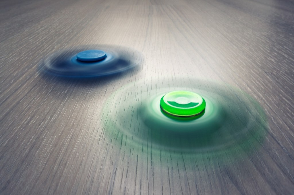 A couple fidget spinners in action. Image by Finmiki from Pixabay. It is common for people with ADHD to fidget and do something to distract themselves.