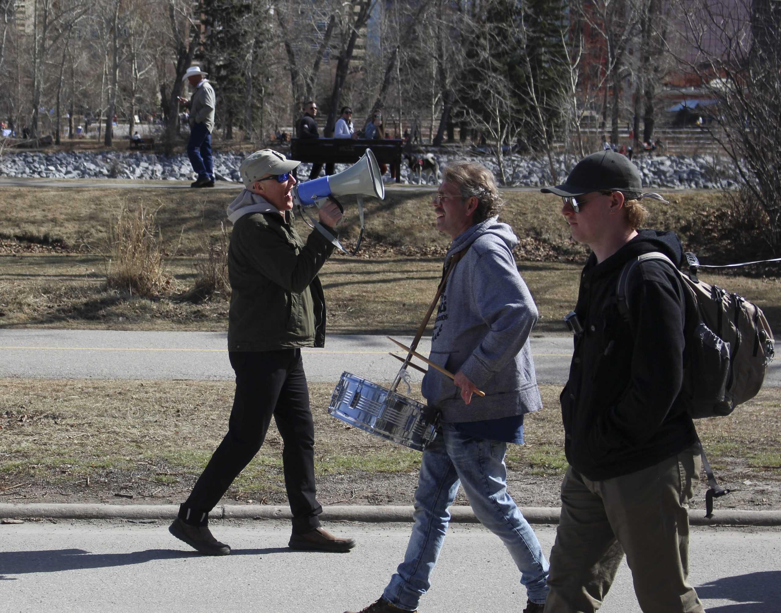 Brad Carrigan marches and holds a megaphone and shouts toward protestors at a Walk for Freedom march on Memorial Drive near the Sunnyside community in Calgary on April 3, 2021. Carrigan is the organizer for Walk for Freedom, and has been since June of 2020. He leads the Walk for Freedom, but he still participates in other protests with Artur Pawlowski, and with the Calgary Freedom Alliance. Walk for Freedom was established by Freedom Unity Alliance, and according to their website, they are a non-profit, non-denominational ministry that represents all people as sovereign beings. Walk for Freedom is a protest against the COVID-19 restrictions, along with the mask mandate. (Photo by Alejandro Melgar/SAIT)