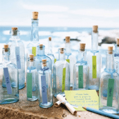 I like the idea of doing messages in a bottle for table assignment.