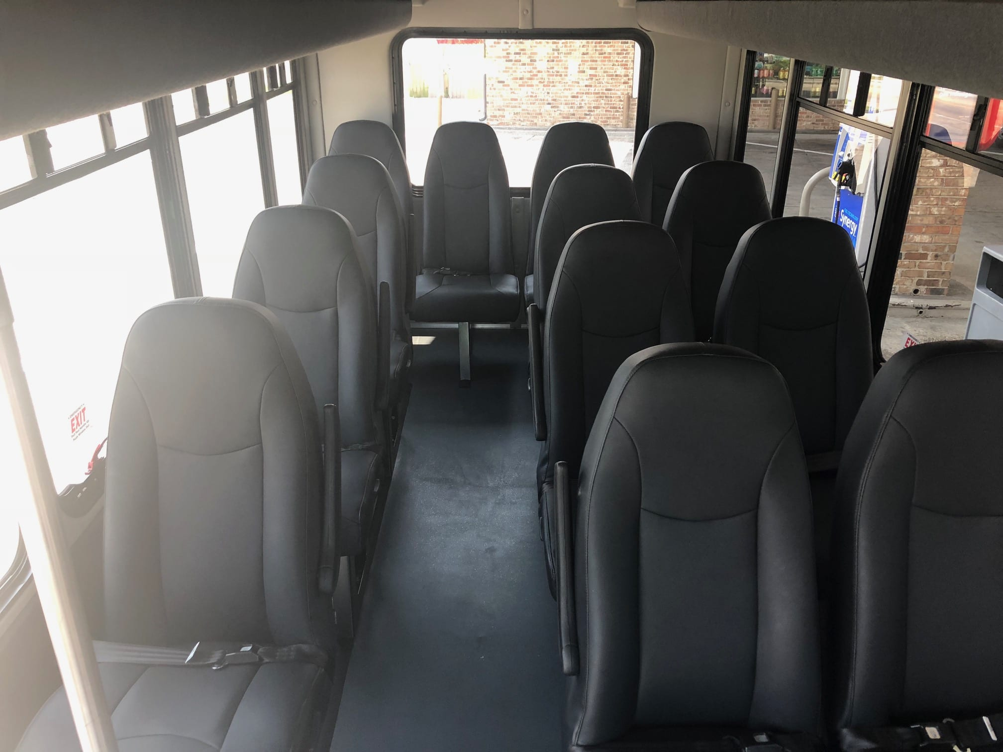 13 passenger White Ford Transit Van