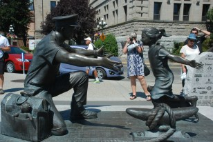 Many Canadians fought in the wars. This is a precious statue with a sailor coming home to hugs!