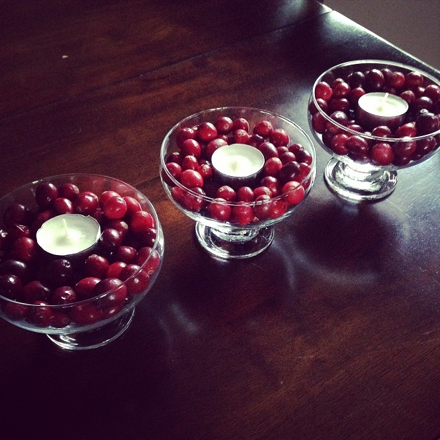 decorating with food! Cranberries, tea light candles, and glasses from your cabinets.