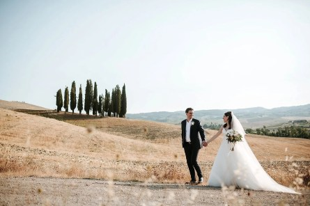 Bride and Groom surrounded by a typical Tuscany scenario.