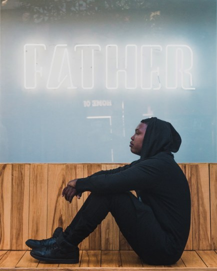 Ricky Tyler in front of Father Coffee neon sign at The Zone in Rosebank