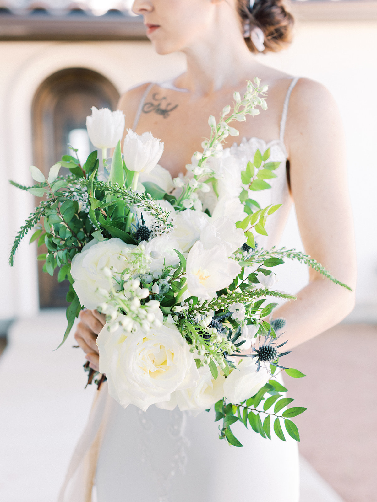 White and greenery wedding bouquet: Elopement vineyard wedding at Umbra Winery by Alexa Kay Events. See more wedding ideas at alexakayevents.com!