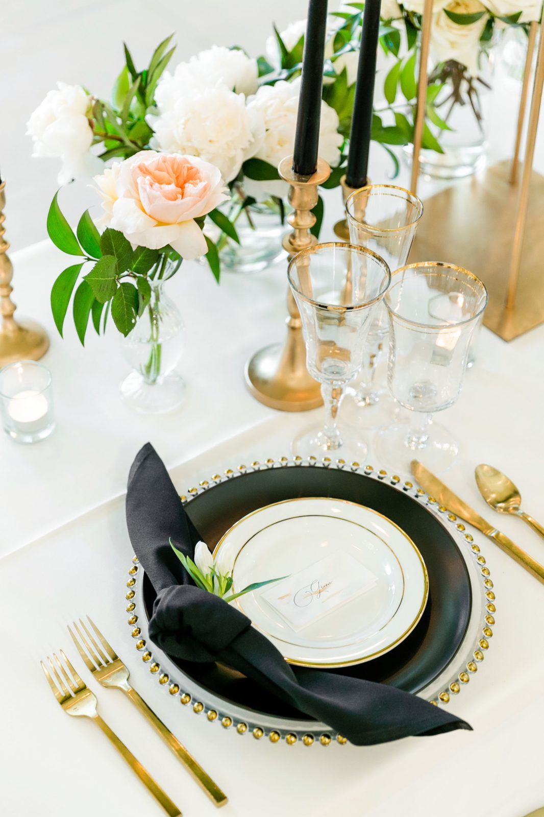 Black and gold wedding place setting: Sophisticated and Chic wedding inspiration on Alexa Kay Events