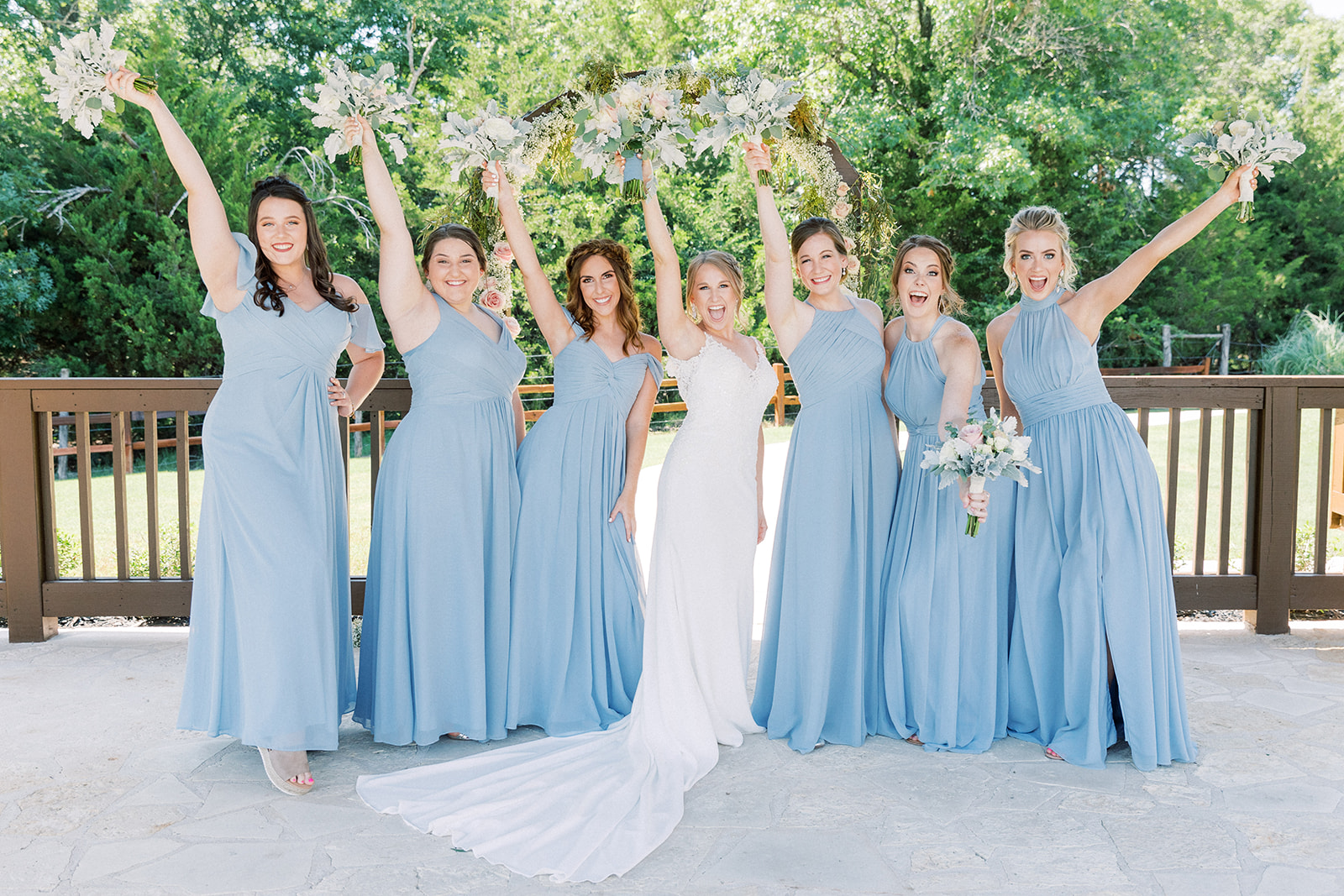 Long blue bridesmaids dresses: | Romantic blue Texas wedding at Spring Venue by Alexa Kay Events