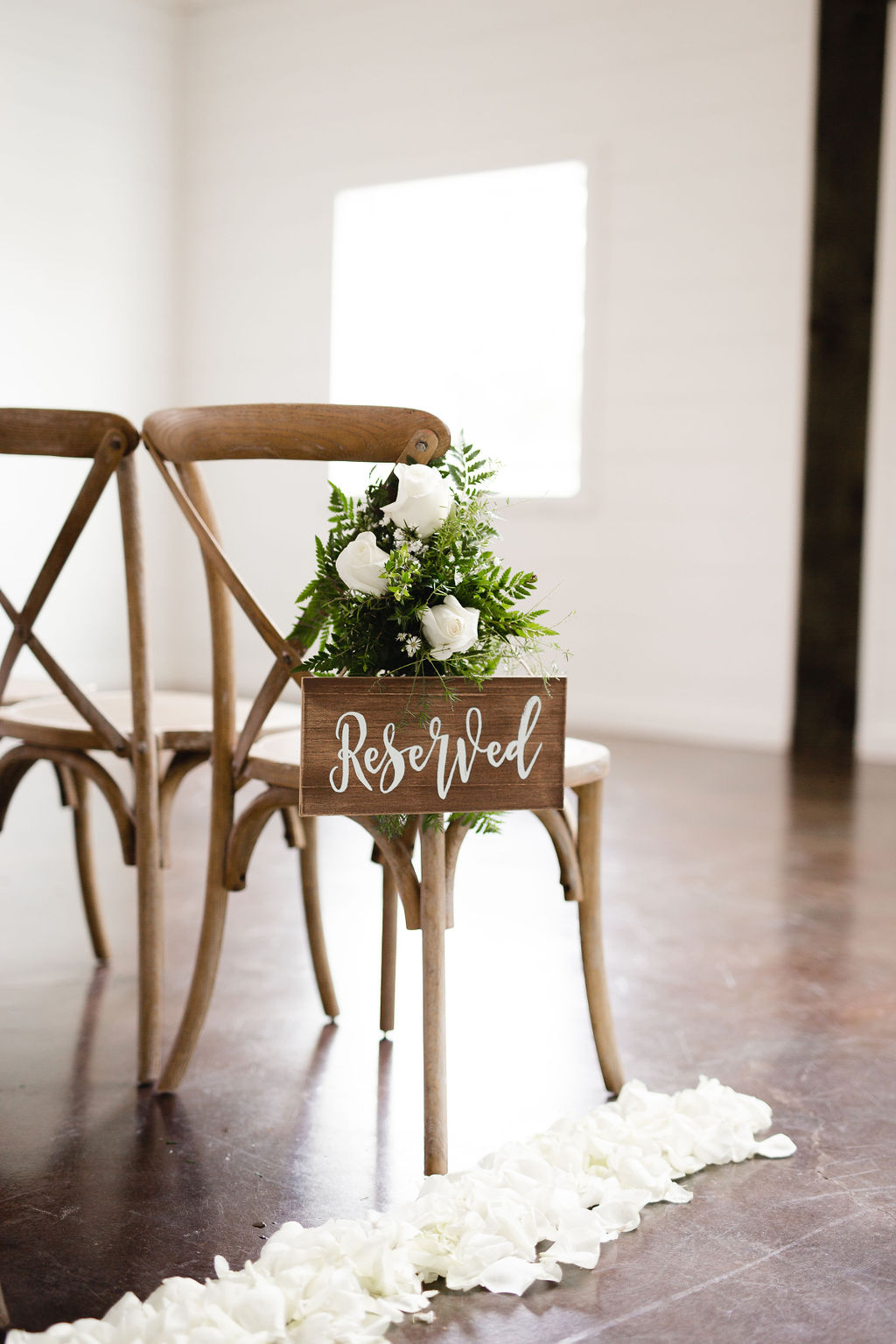Wooden wedding ceremony chair sign