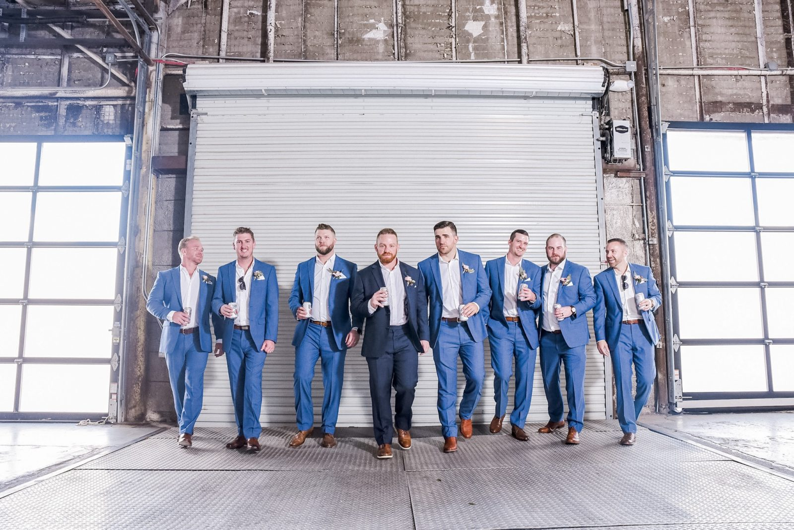 Blue groom and groomsmen wedding tuxedo