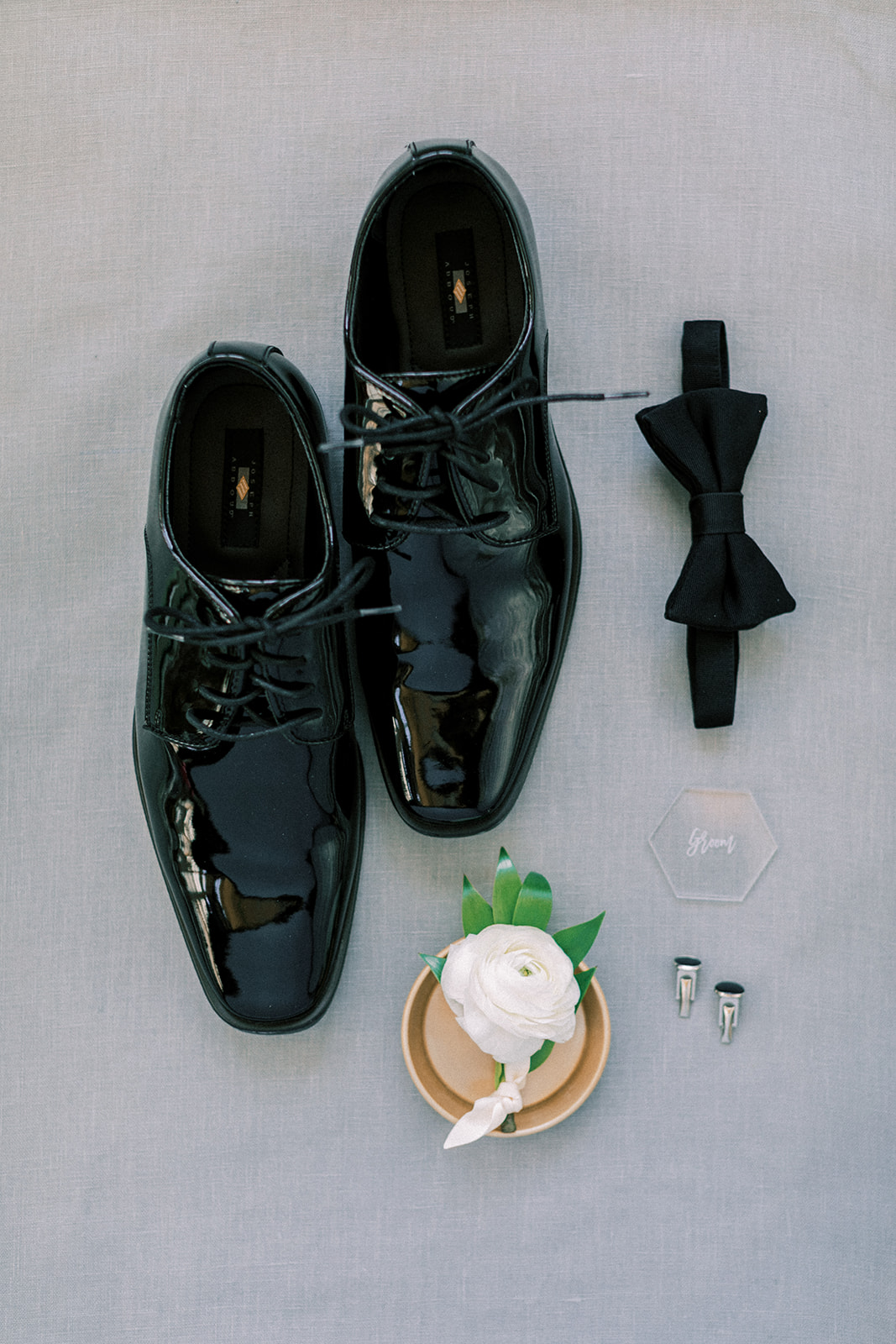 Groom's shoes and black bow tie