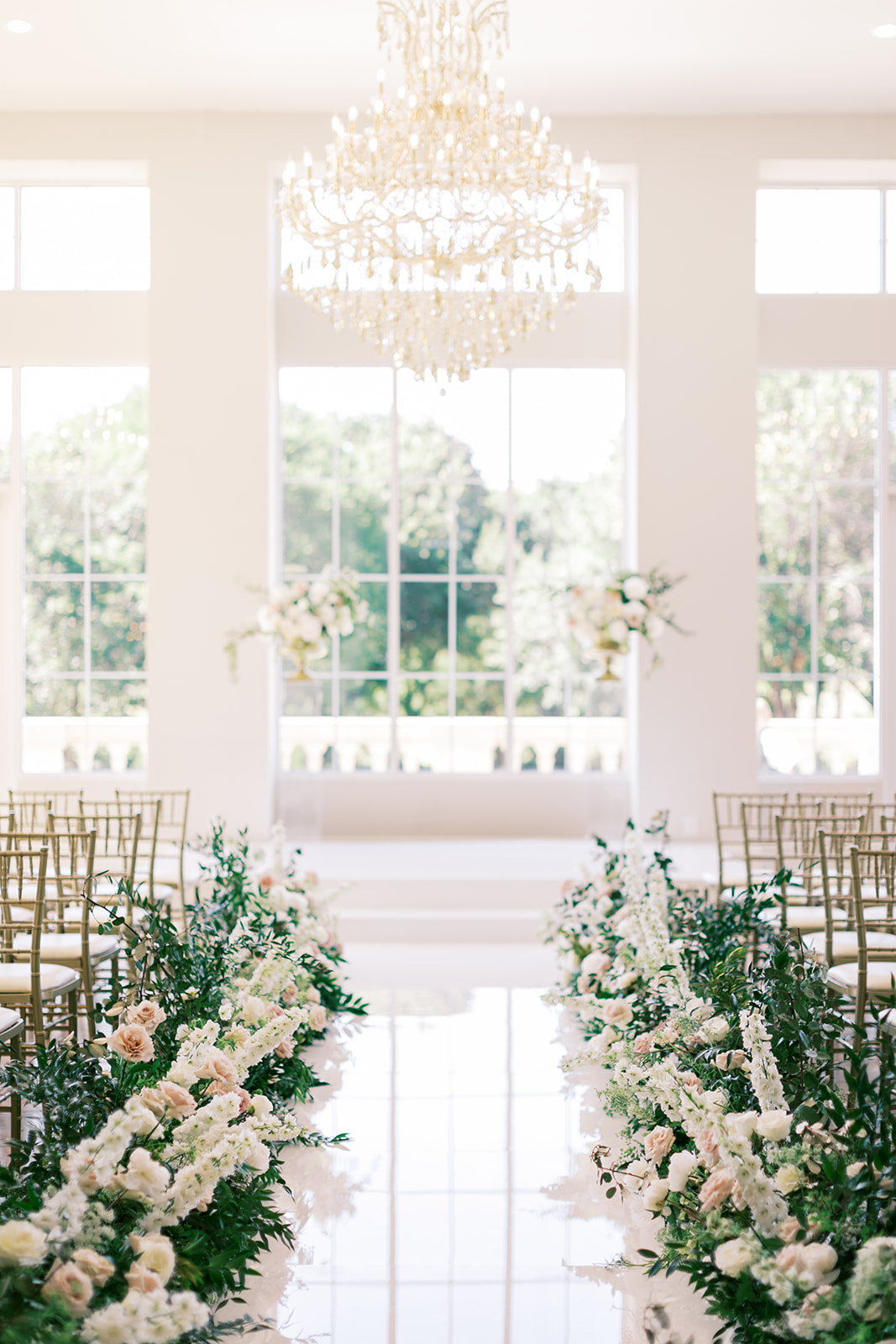 Floral-filled wedding ceremony decor at The Olana, Texas