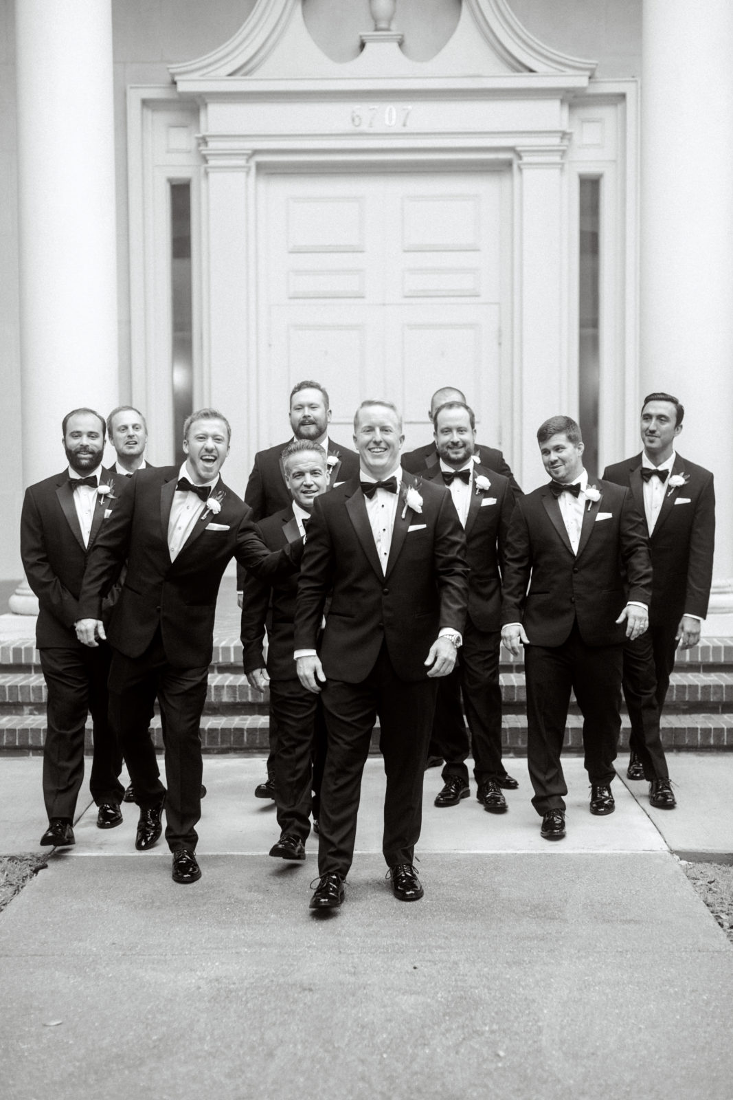 Black and white portrait of groom and groomsmen