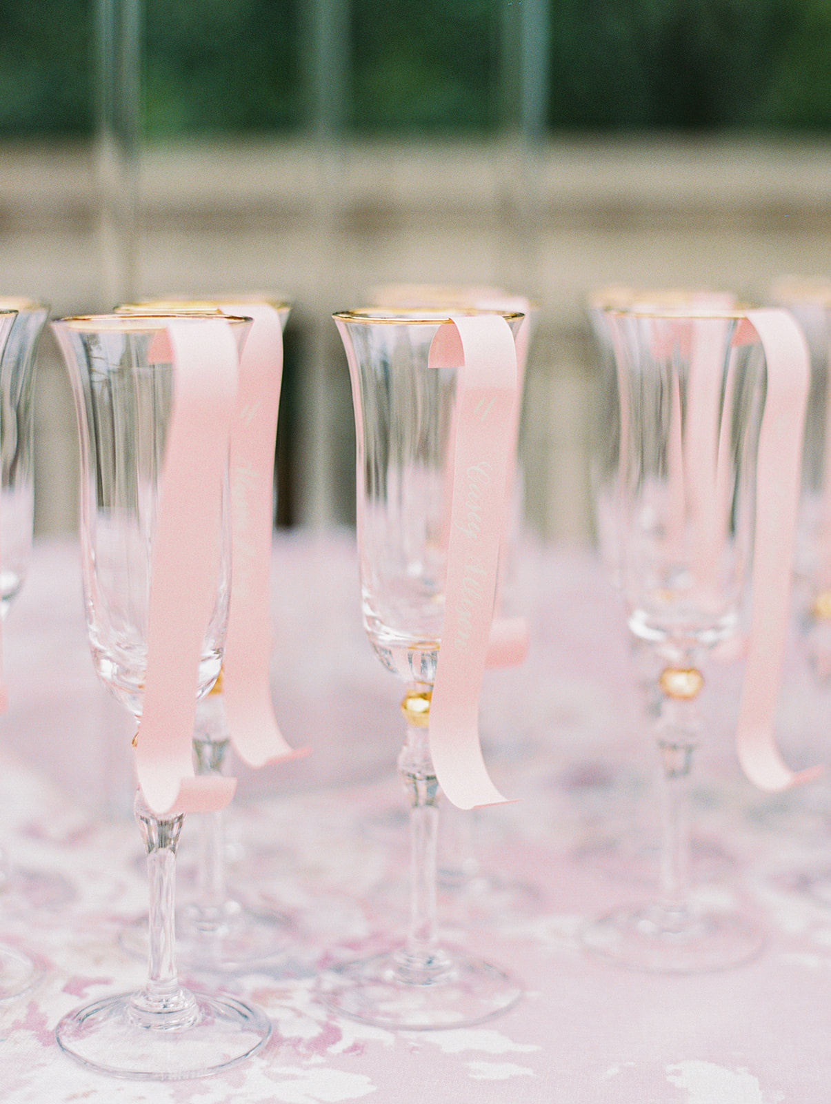 Pink and white champagne wedding escort cards | Alexa Kay Events