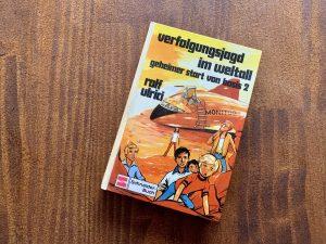 Verfolgungsjagd im Weltall - Rolf Ulrici - Illustration: Hans Held - Buchcover