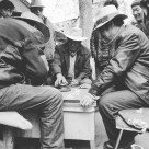Locals playing dice on the streetside
