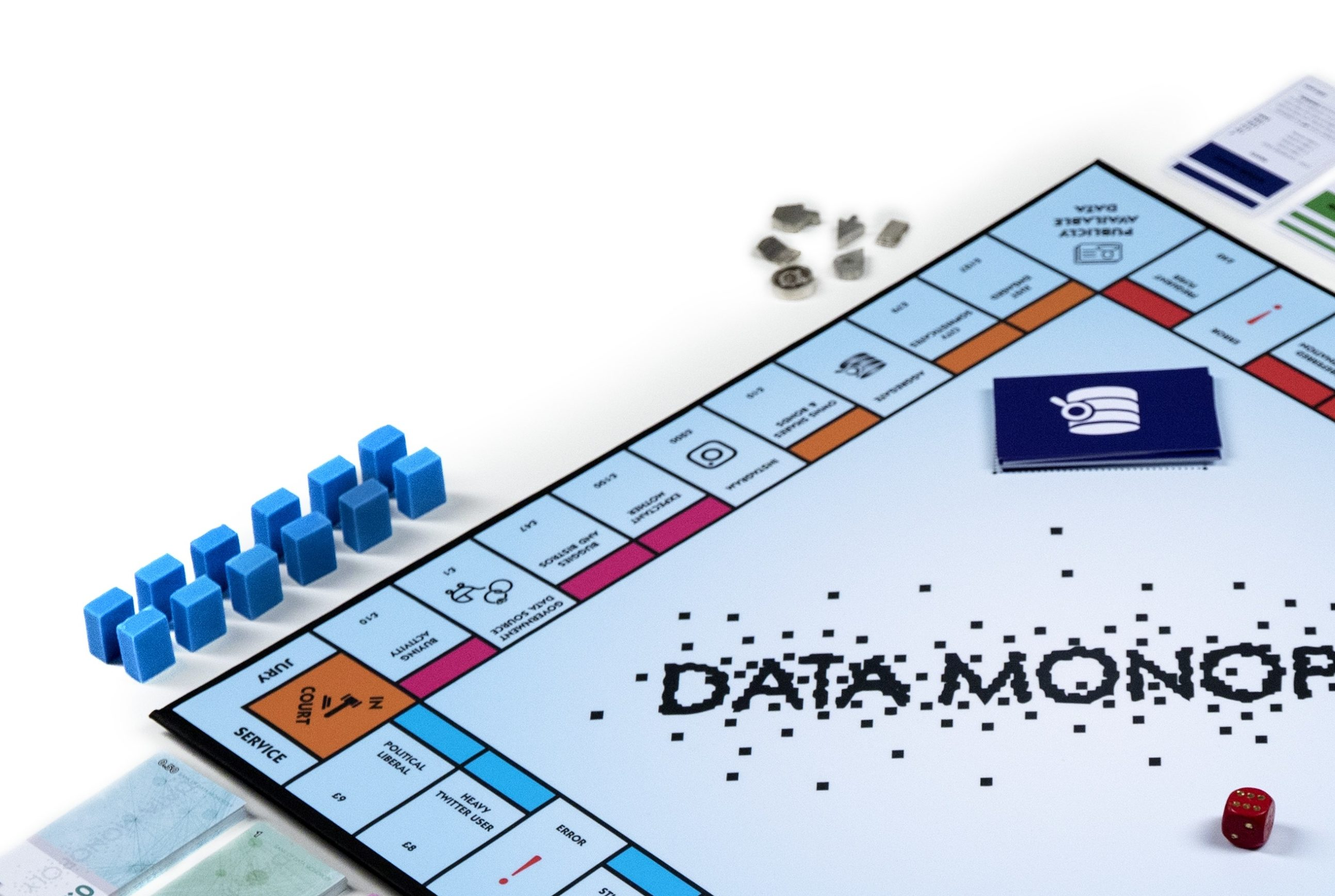 monopoly boardgame with cards and fields presenting data capitalism categories - by Anya Mooney