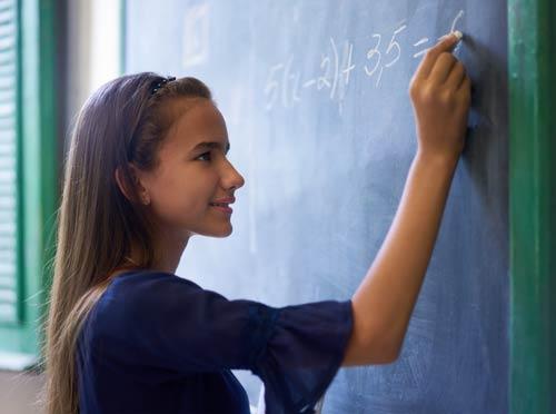Girl-doing-math-at-chalkboard