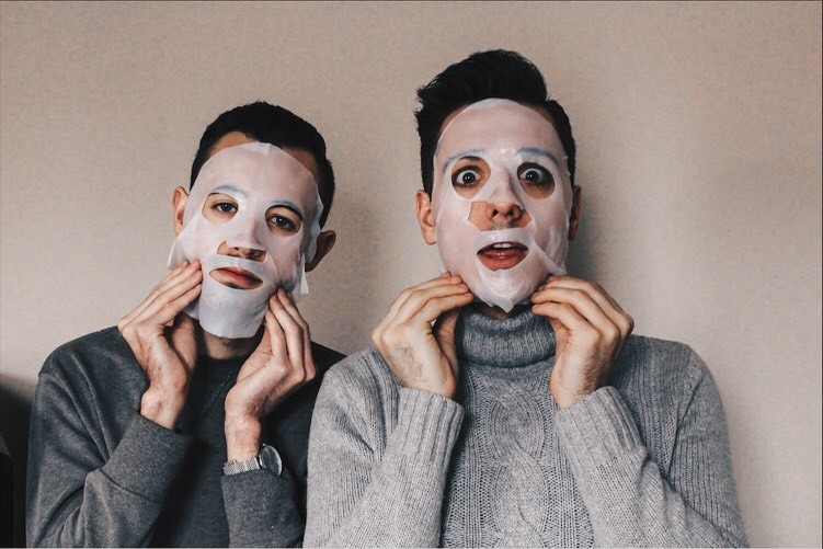 mike and alex with sheet masks on their face