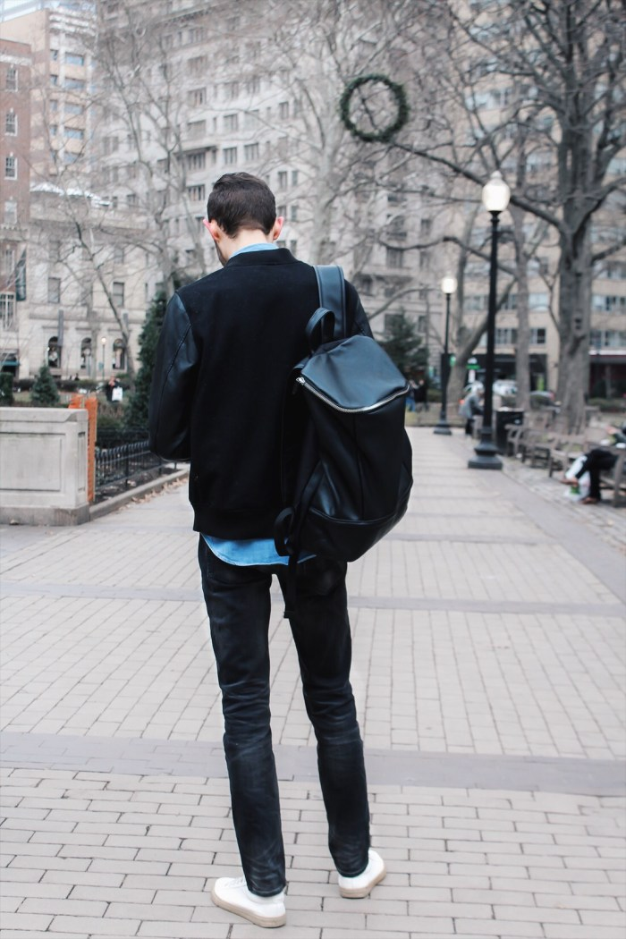 alex in the park with leather bookbag