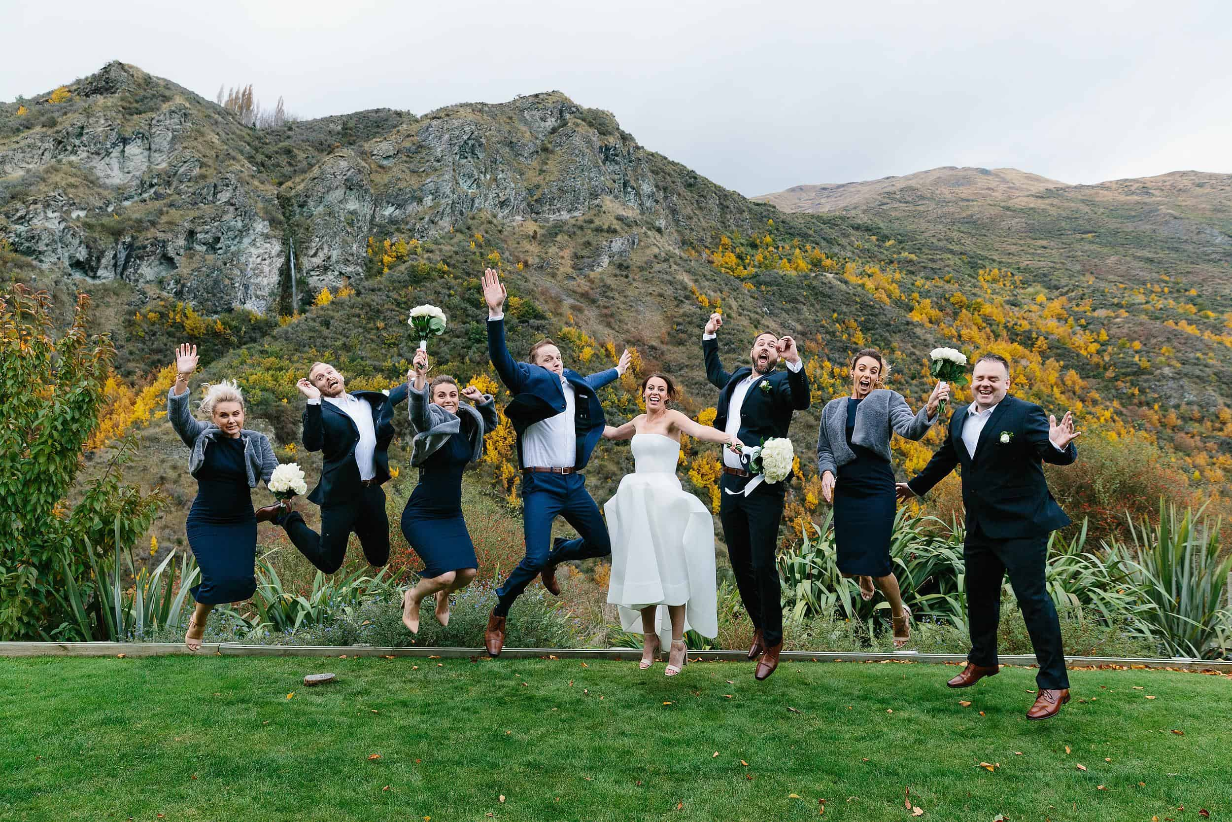 Wedding party jump in the air
