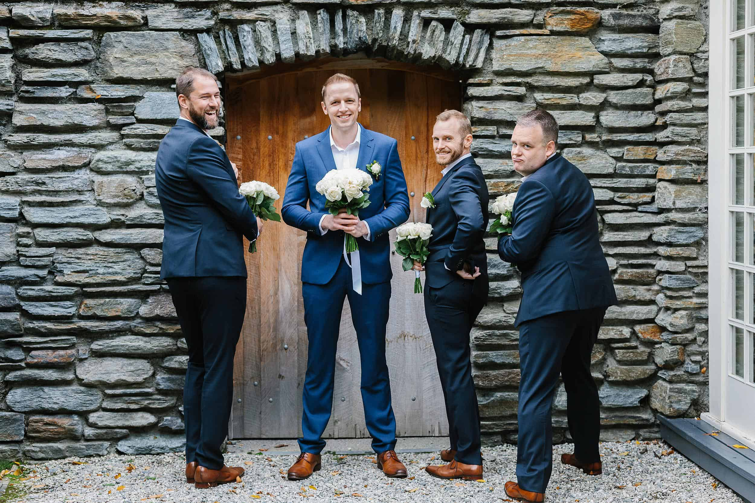 Groom with groomsmen being silly