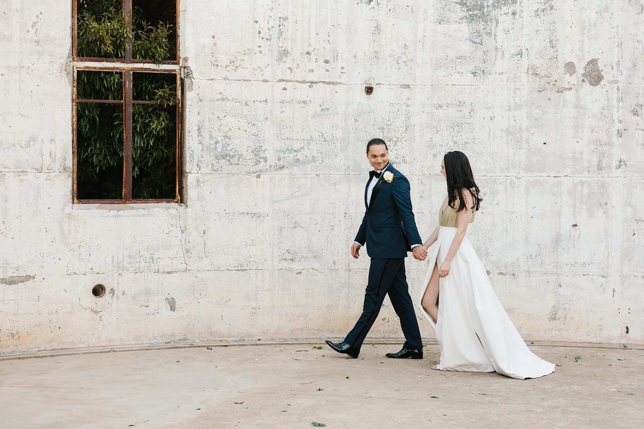 Bride and groom walk in the Yale Columbia Dome on Mt Stromlo, Canberra