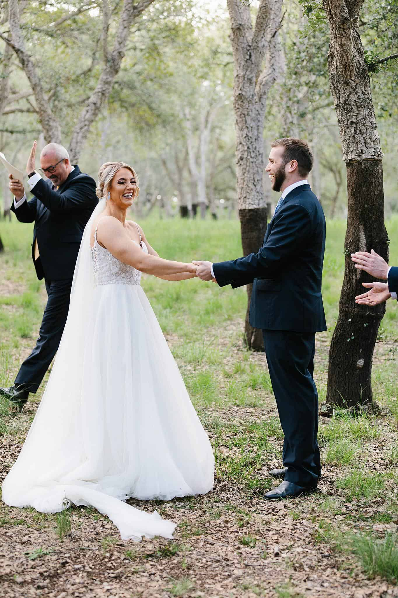 Celebrant claps as bride and groom are freshly married
