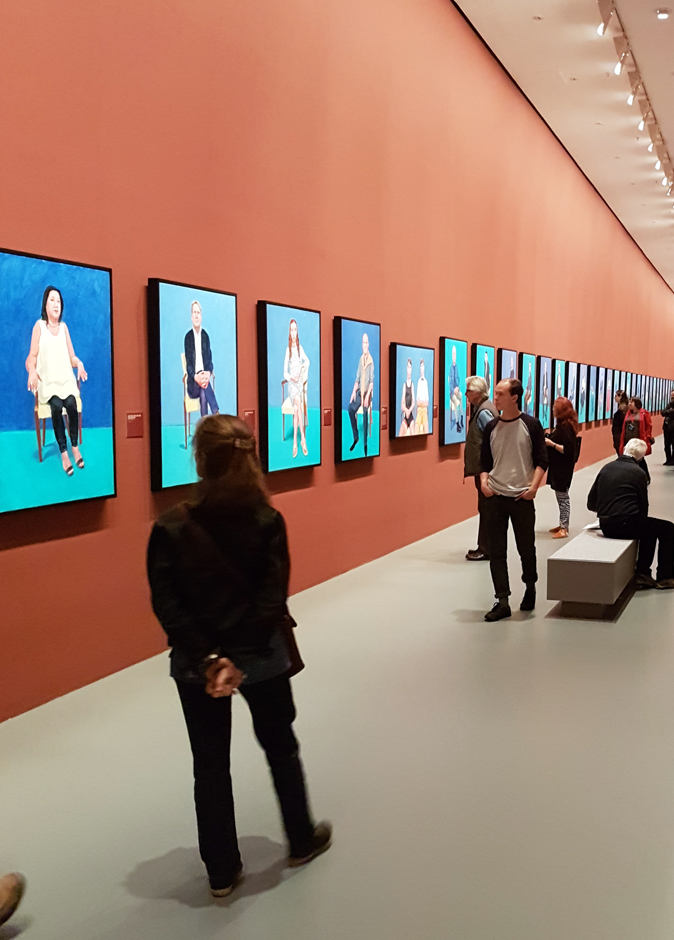 Image of David Hockney's portraits installed at the NGV