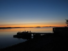 Sunrise and a calm harbour on Nova Scotia's East Coast. Traditional and unceded territory of the Mi'kmaq People.
