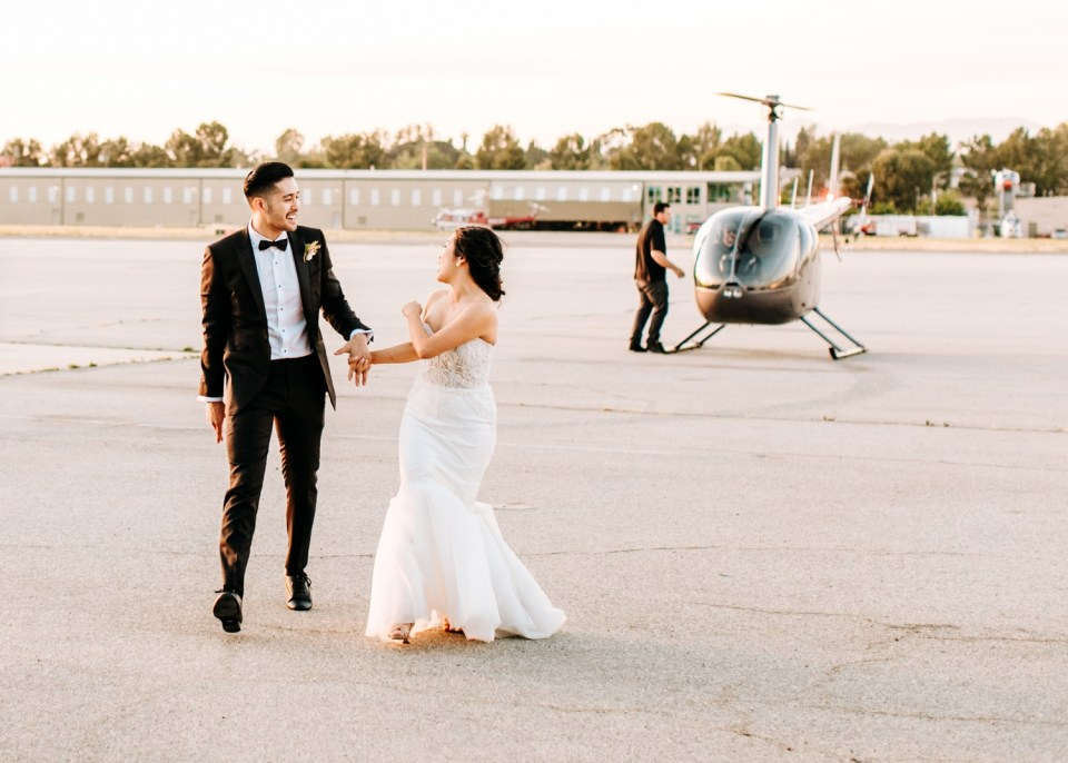 helicopter entrance at wedding reception at Hangar 21 South