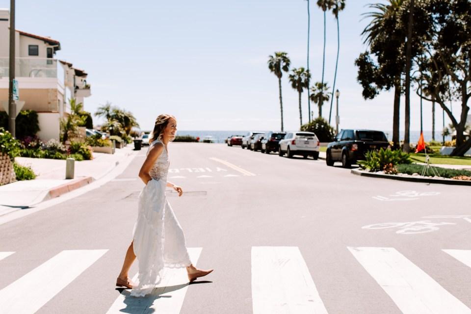 bride crossing the street in san clemente