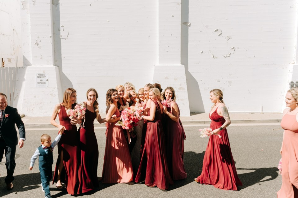 pink and red wedding party dresses, wedding party photos at Casino San Clemente