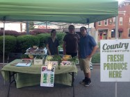 Rural Action and ACEnet employees working the Country Fresh Stop pop-up produce stand.