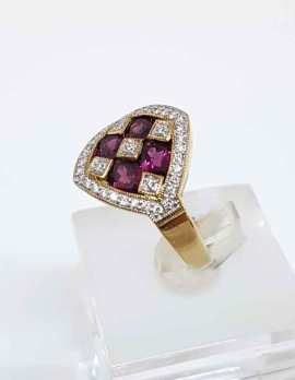 9ct gold square ring - 4 garnets and diamonds