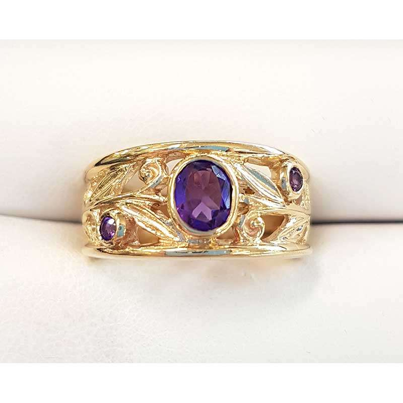 Gold ring featuring 3 oval amethysts