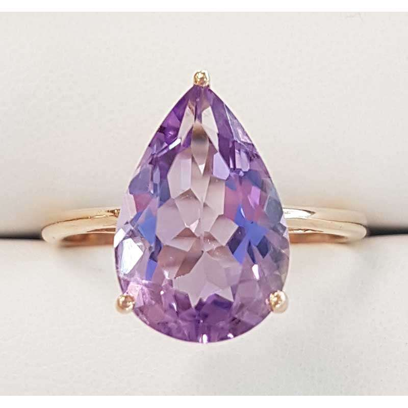 Rose Gold ring and teardrop shaped amethyst