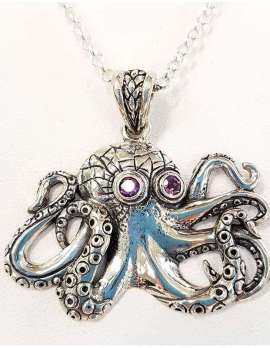 Sterling silver octopus necklace with amethyst eyes