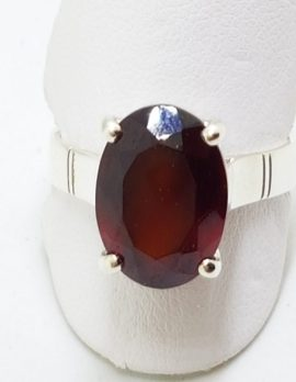Sterling Silver Garnet Oval Claw Set Ring