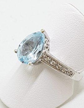 9ct White Gold Teardrop/Pear Shape Blue Topaz and Diamond Ring
