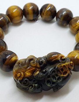 Large Carved and Round Tiger Eye Elastic Bead Bracelet