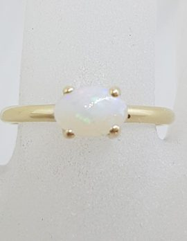 9ct Yellow Gold Oval Claw Set Solid White Opal Ring