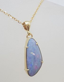 9ct Yellow Gold Odd Shape Blue Opal Claw Set Pendant on Gold Chain