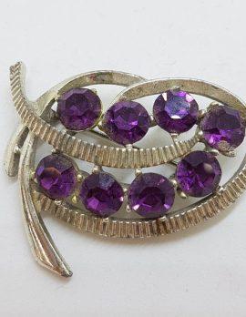Plated Purple Rhinestone Twist Shape Brooch - Vintage Costume Jewellery