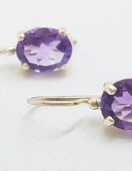 Sterling Silver Oval Claw Set Amethyst Drop Earrings