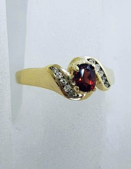 9ct Yellow Gold Oval Claw Set Garnet with Channel Set Diamond Ring