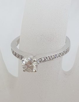 18ct White Gold Diamond Engagement Ring with Claw Set Centre Diamond and Diamonds Along the Shoulder