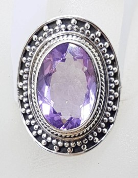 Sterling Silver Large Oval Amethyst with Patterned Rim Ring