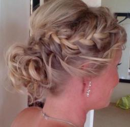 loose low bun curly and braid