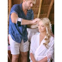 Finishing the hair in Tulum for bride Shannon