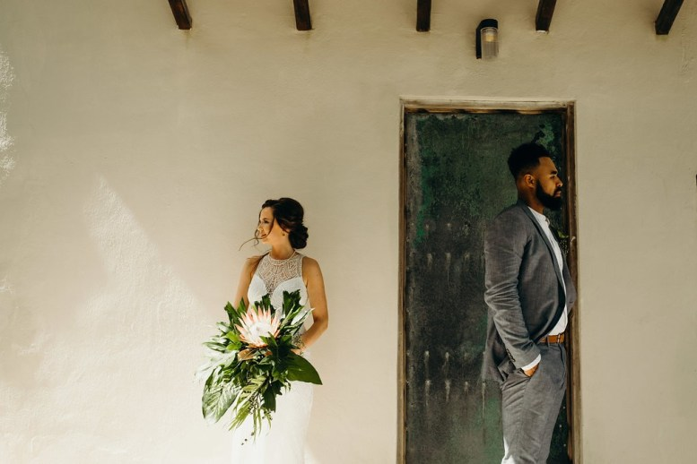couples poses on their elopement day in tulum